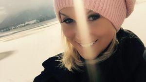 Katja Kühne mit einer rosafarbenen Mütze