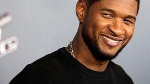 Usher lachend