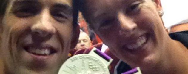 Michael Phelps mit Goldmedaillen