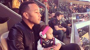 John Legend und Tochter Luna bei einem Sportevent