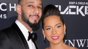Swizz Beatz hält Alicia Keys Bauch