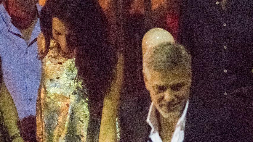 Amal und George Clooney bei einem Restaurantbesuch am Comer See, Juli 2021