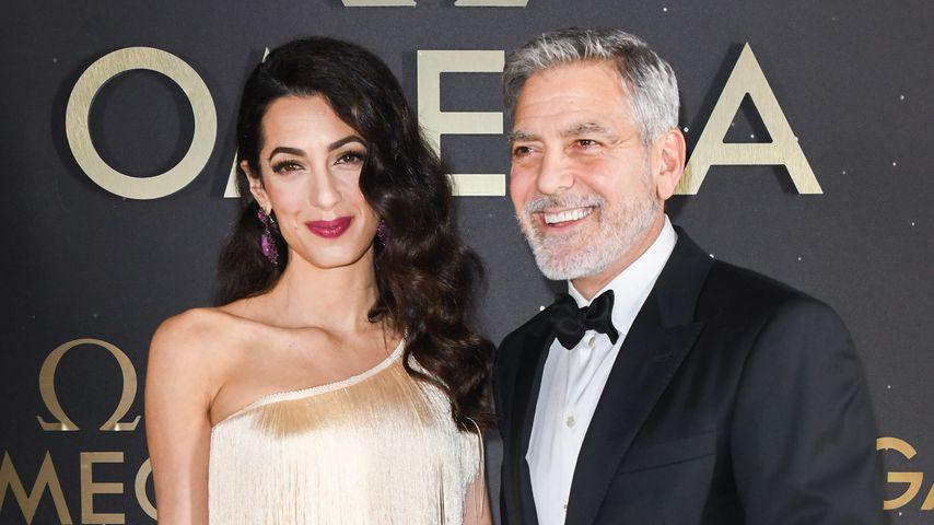 Amal und George Clooney bei einem Event in Florida