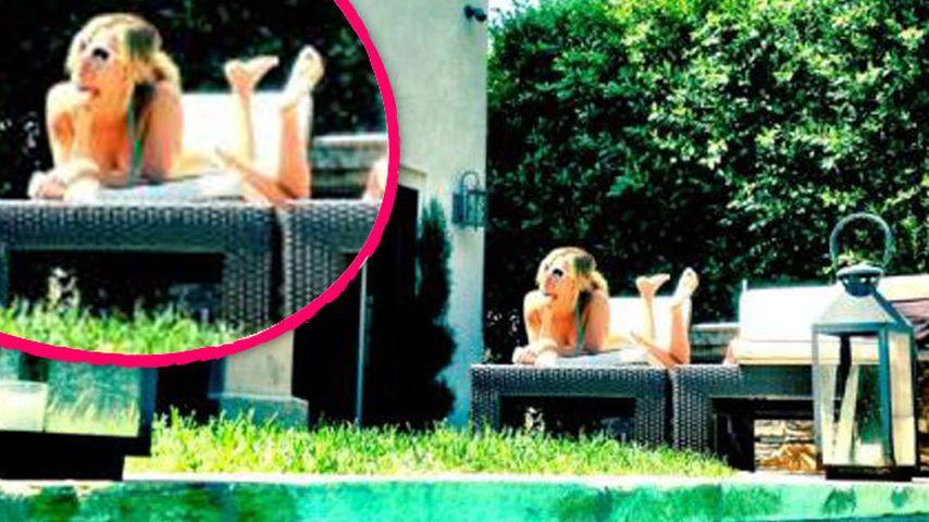 Ashley Tisdale relaxt im Bikini mit ihrem Verehrer