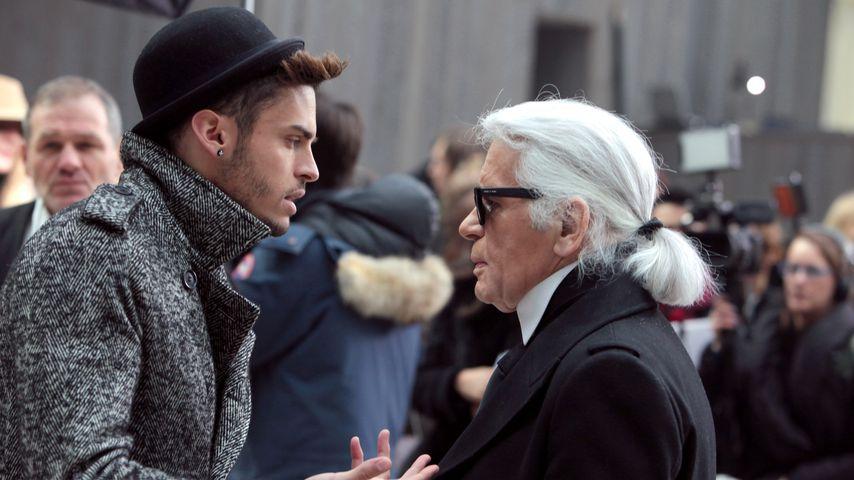 Baptiste Giabiconi und Karl Lagerfeld währen der Chanel Haute Couture Show im Januar 2013