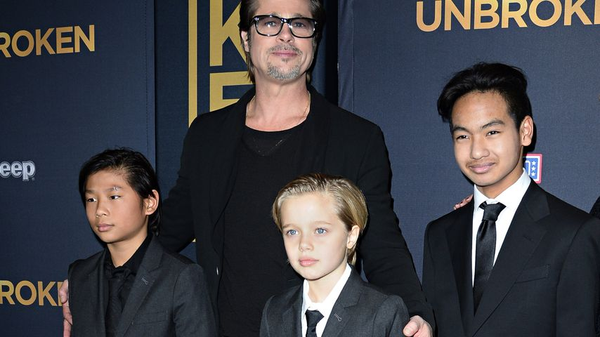"""Brad Pitt mit Pax, Shiloh und Maddox bei der Premiere des Films """"Unbroken"""""""