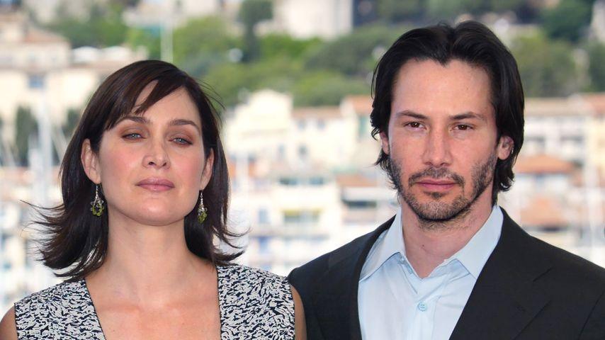 Carrie-Anne Moss und Keanu Reeves, 2003