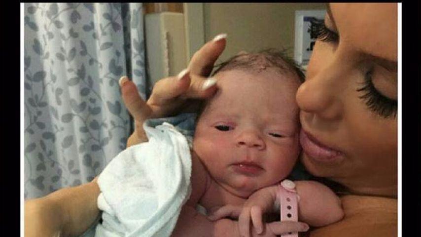 Coco mit ihrer Tochter Chanel Nicole kurz nach deren Geburt