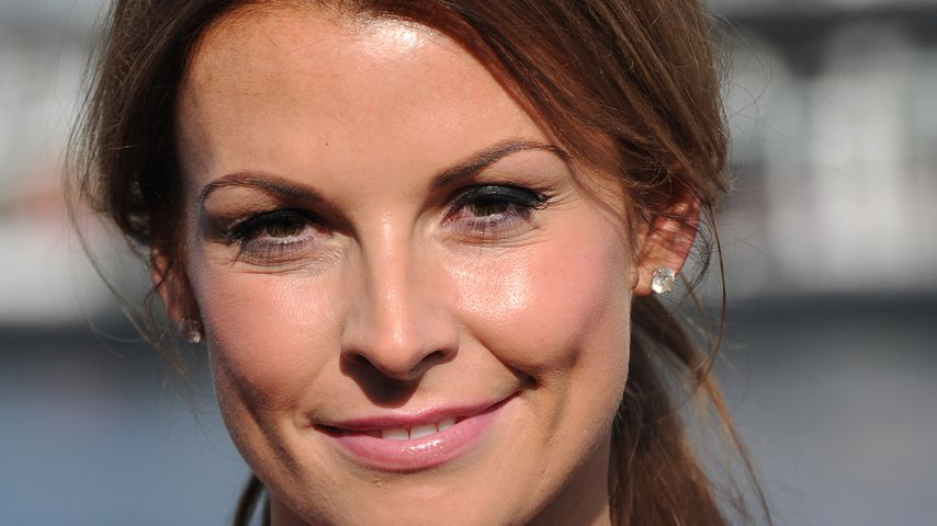 Coleen Rooney bei einem Fototermin in London