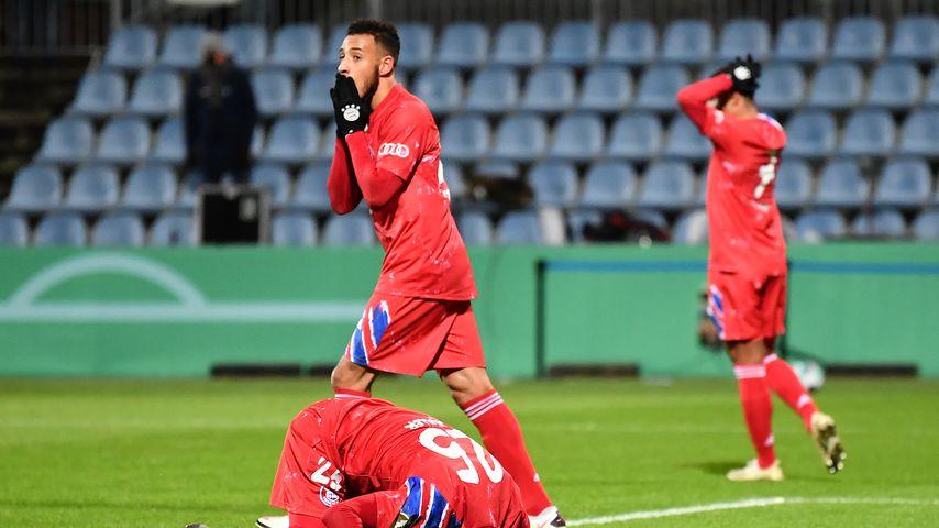Corentin Tolisso und Thomas Müller beim Spiel gegen Holstein Kiel