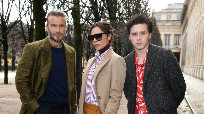 David, Victoria und Brooklyn Beckham auf der Paris Fashion Week