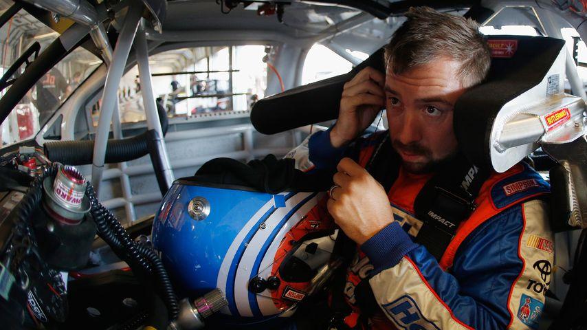 Eric McClure im Jahr 2014 im Cockpit seines Wagens