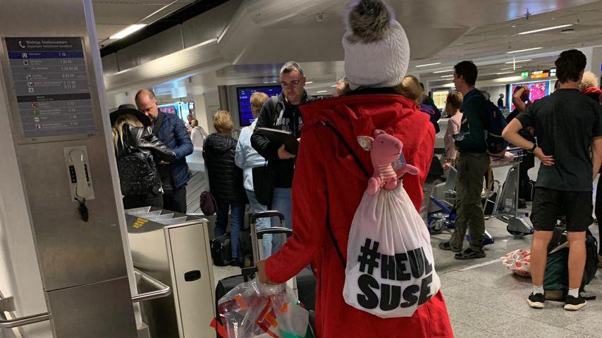 Gisele Oppermann am Frankfurter Flughafen