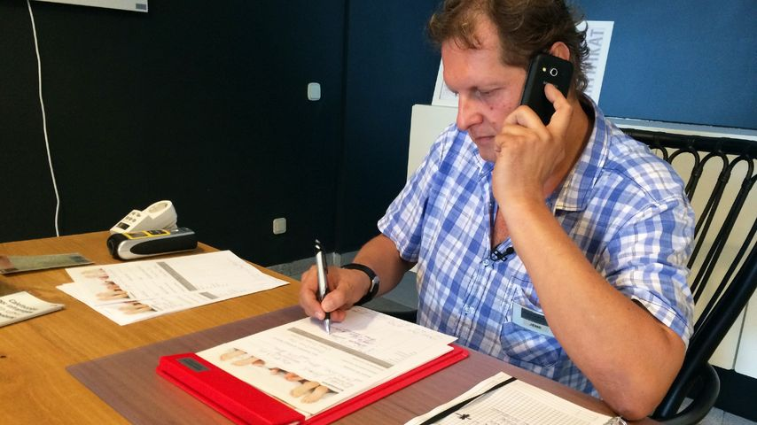 Jens Büchner arbeitet im Büro