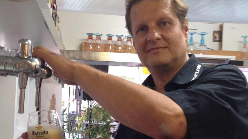 Jens Büchner zapft Bier