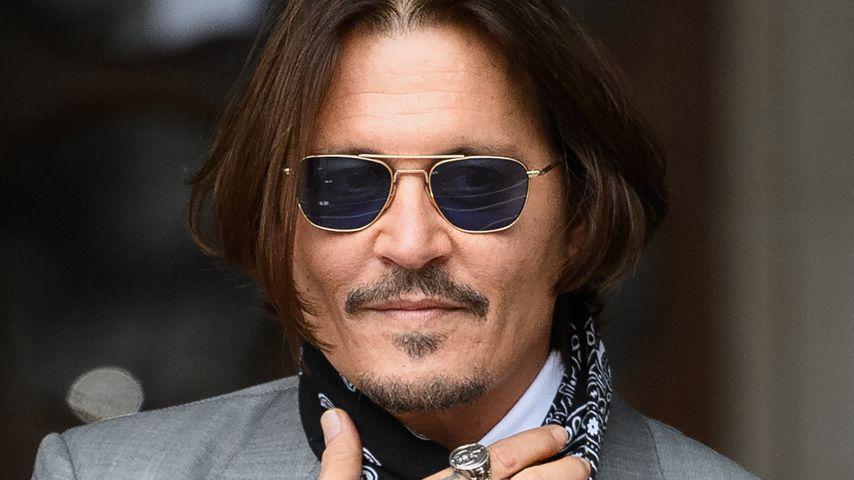 Johnny Depp steht vor den Royal Courts of Justice in London, 2020