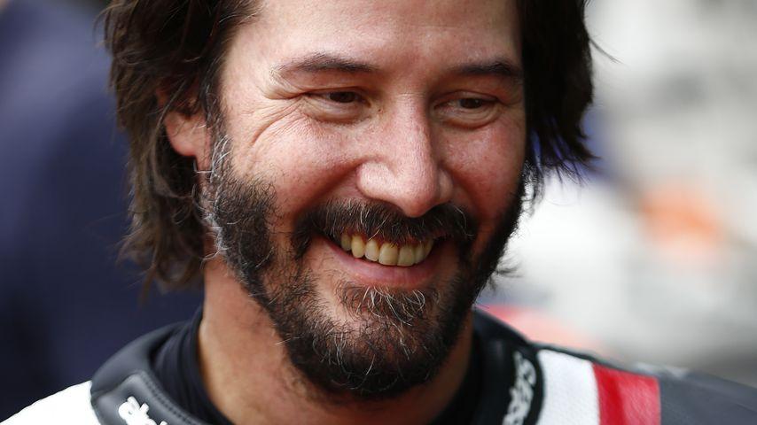 Keanu Reeves bei einem Motorradrennen in England