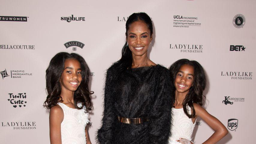 Kim Porter (m.) mit ihren Kindern D'Lila Star und Jessie James