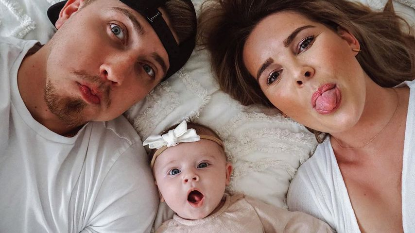 Leons und Christin Kaeber mit ihrer Tochter Nia
