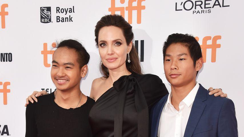 Maddox, Angelina und Pax Jolie-Pitt 2017 in Toronto, Kanada
