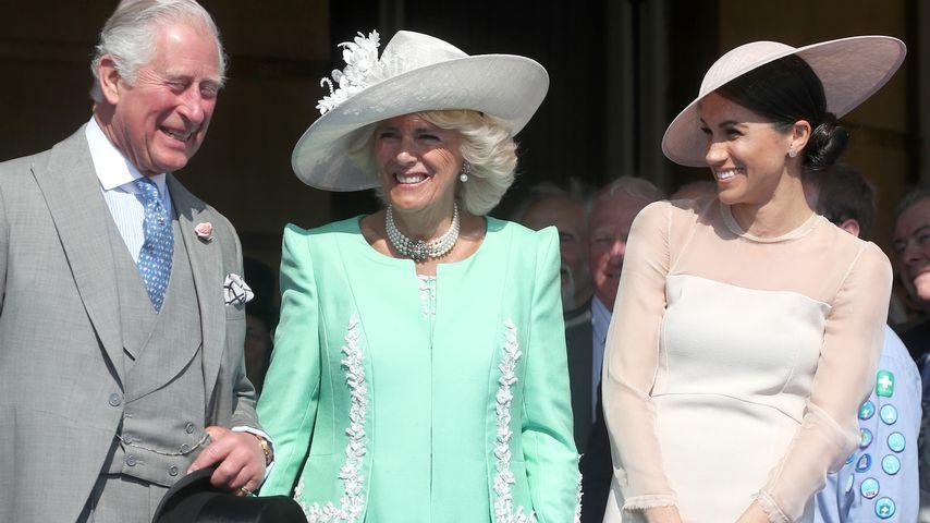 Prinz Charles, Herzogin Camilla und Hezogin Meghan am Buckingham Palast im Mai 2018