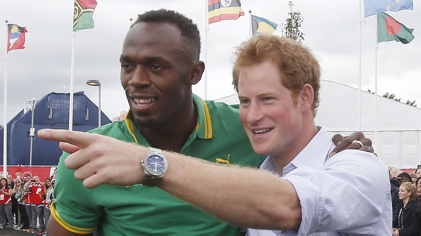 Usain Bolt und Prinz Harry 2014 in Schottland