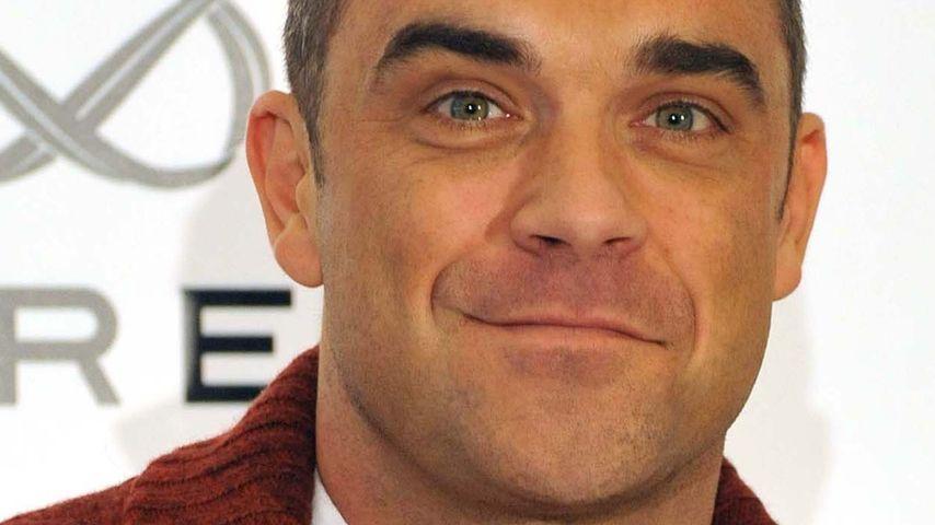 Robbie Williams trällert mit Miss Piggy & Kermit