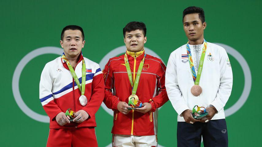 Om Yun-chol, Long Quingquan, Sinphet Kruaithong (v.l.n.r)