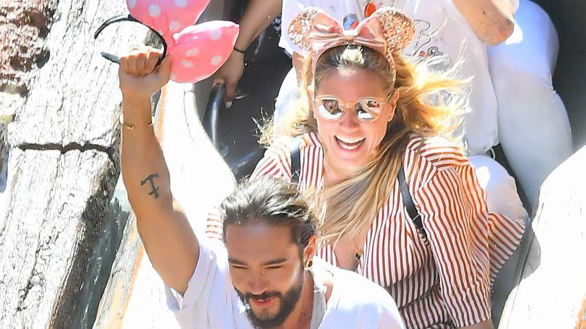 Tom Kaulitz, Heidi Klum und Bill Kaulitz (von unten) im Disneyland