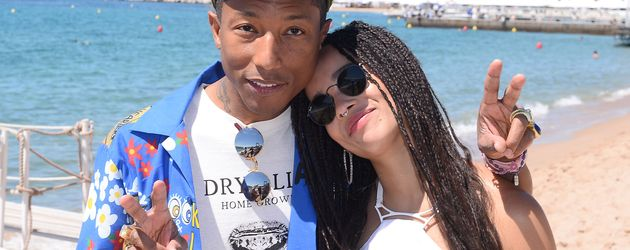 Zoe Kravitz und Pharrell Williams